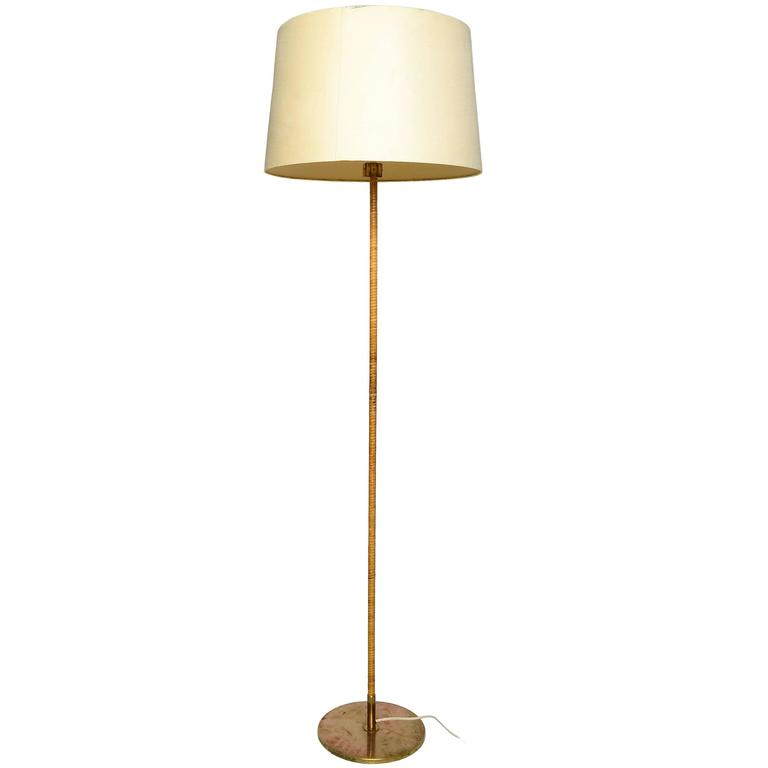 Paavo Tynell Floor Lamp in Brass and Cane at 1stdibs