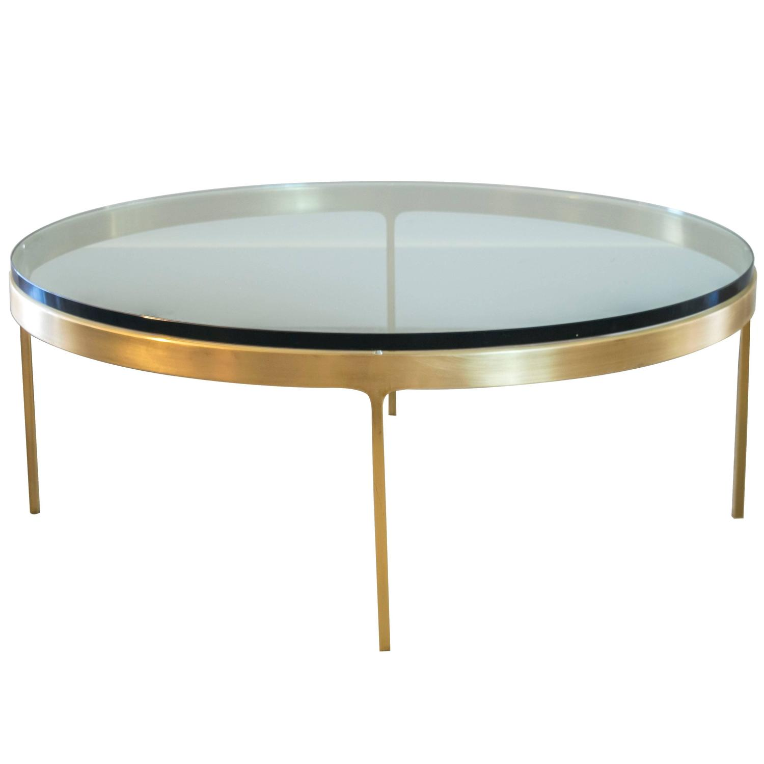 Solid brass round coffee table by nicos zographos at 1stdibs One of a kind coffee tables