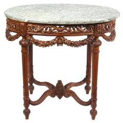 Louis XVI Style Carved Fruitwood Marble-Top Center Table, Mid-19th Century