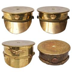 Collection of Four Brass 'Trench Art' Military Caps or Kepis WWI