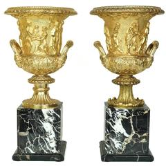 Pair of Neoclassical Gilt Bronze Figural Medici Style Urns on Marble Base