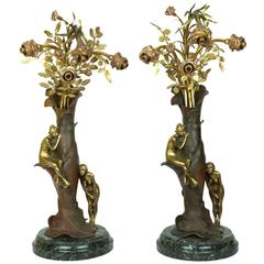 Pair of Art Nouveau Two-Toned Bronze Figural Lamps on Marble Base