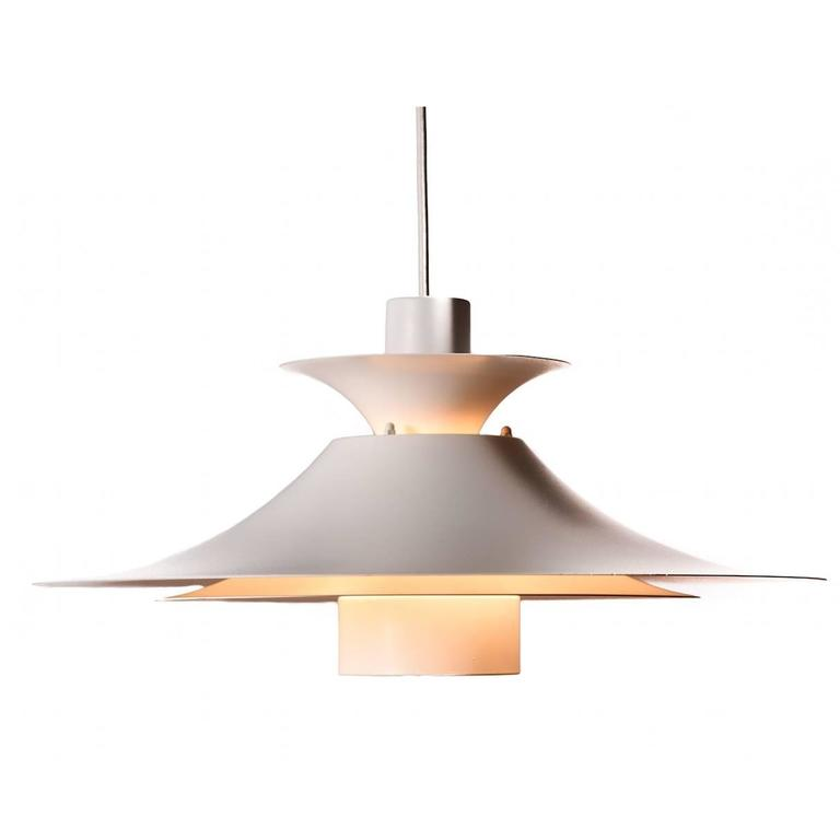 this danish modern three tiered pendant light is no longer available