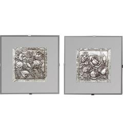 Pair of Silver Floral Reposed Elements in a Mirrored Frame