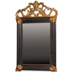 Italian baroque style  Mirror with hand-carved gilt details, aged mirror glass