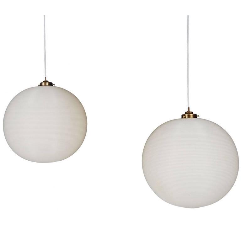 Pair of Rotoflex Pendant Lights by Heifetz