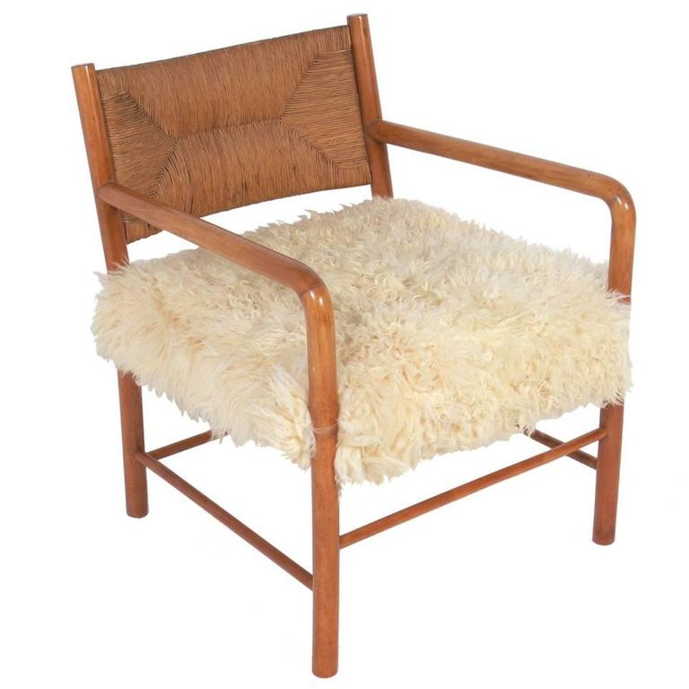 Italian Midcentury Lounge Chair In Woven Paper Cord And Sheepskin For Sale