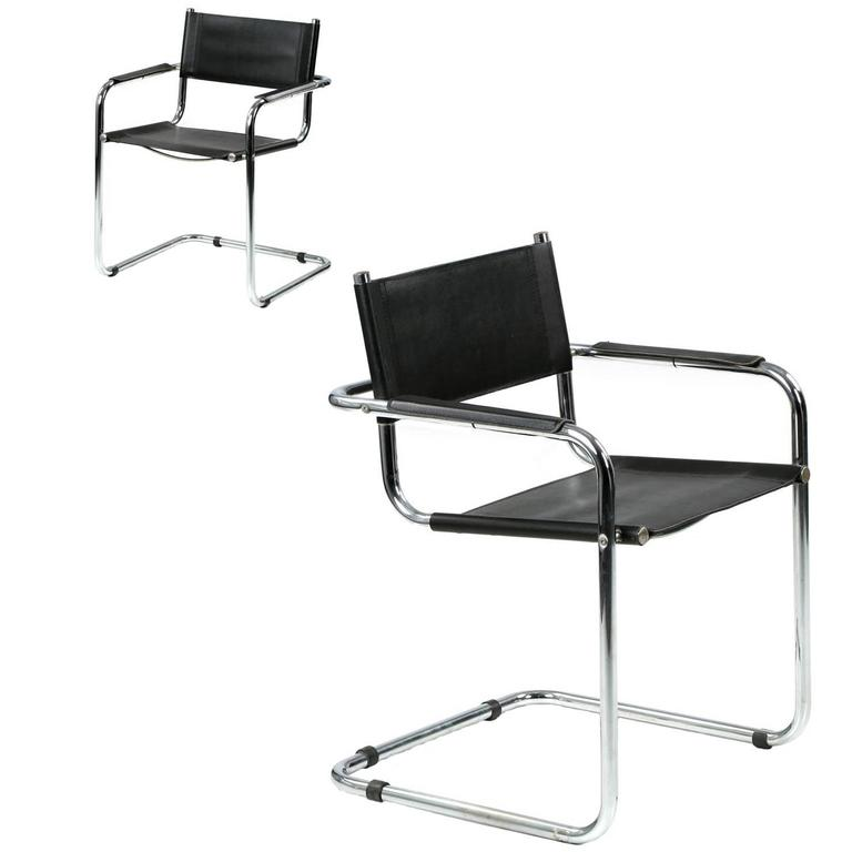 pair of mid century modern chrome and leather cantilever arm chairs