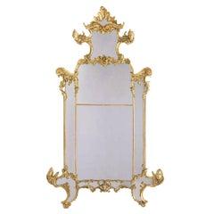 Palatial Italian 19th Century Rococo Carved Giltwood Figural Mirror, circa 1850