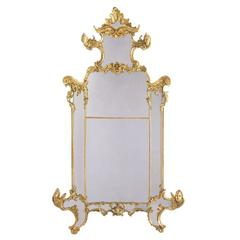 Palatial Italian 19th Century Rococo Carved Giltwood Figural Mirror, circa 1850