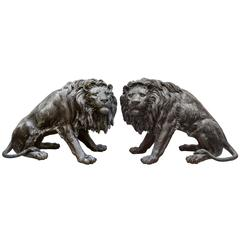 Pair of Almost Lifesize Cast Bronze Lion Statues