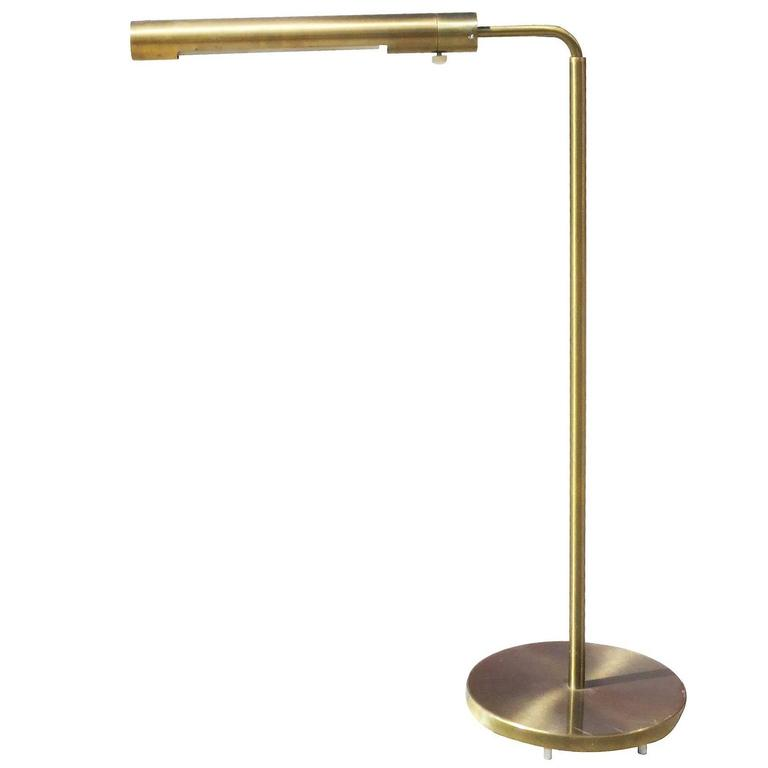 Long cylinder form brass reading floor lamp by casella for for Floor lamps reading lights
