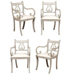 Four Swedish 1900s Lyre Back Painted Armchairs with Scrolled Arms and Saber Legs