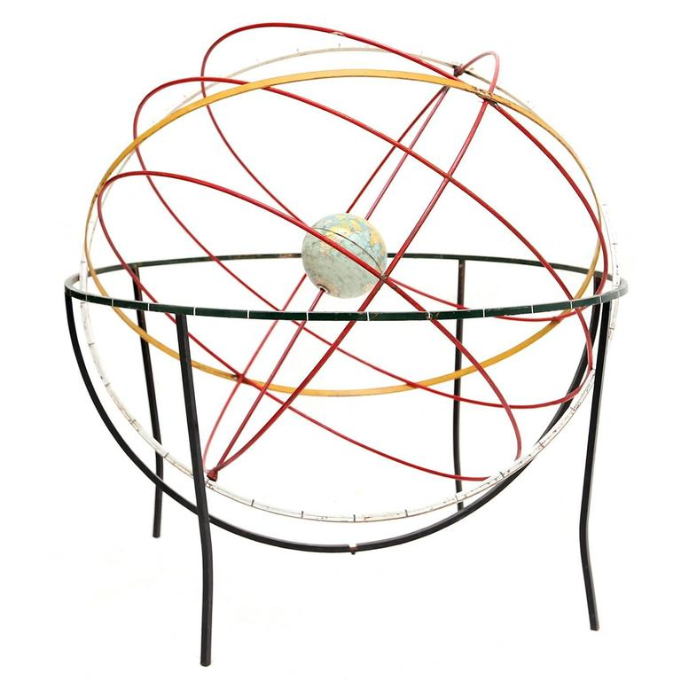 Decorative kinetic sculpture of the earth and orbits For Sale
