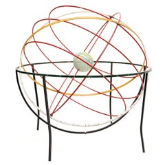 kinetic sculpture of the earth and orbits