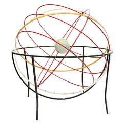 Decorative kinetic sculpture of the earth and orbits