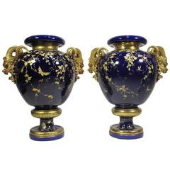 Fine Pair of 19th Century Cobalt-Blue and Parcel-Gilt Majolica Figural Vases