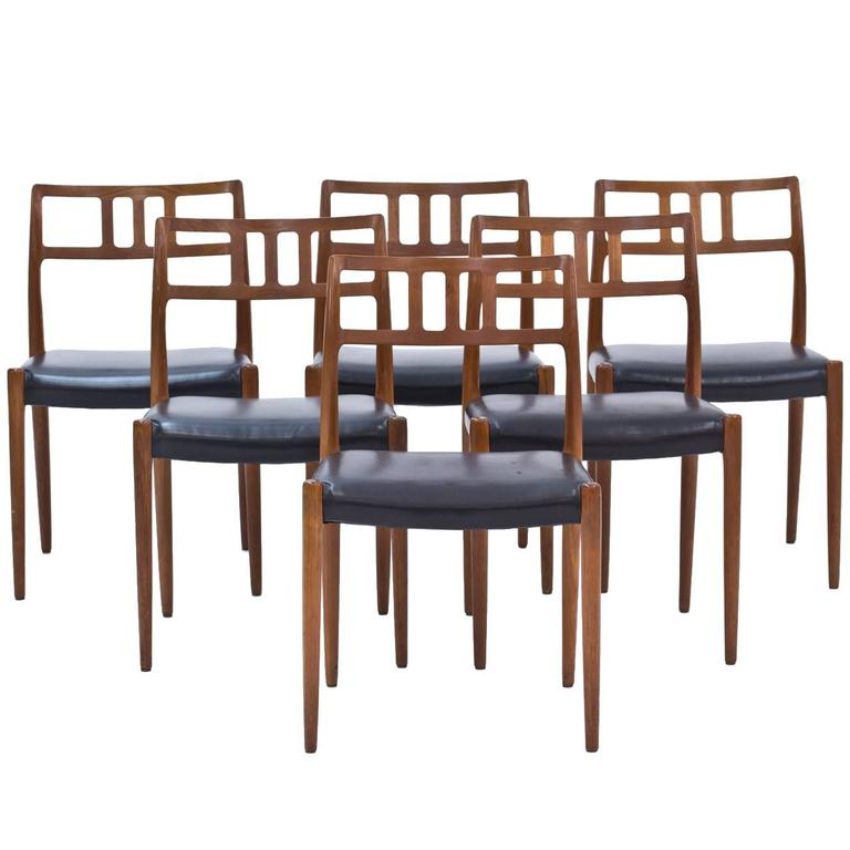 Set Of Six Rosewood And Black Leather Dining Chairs By