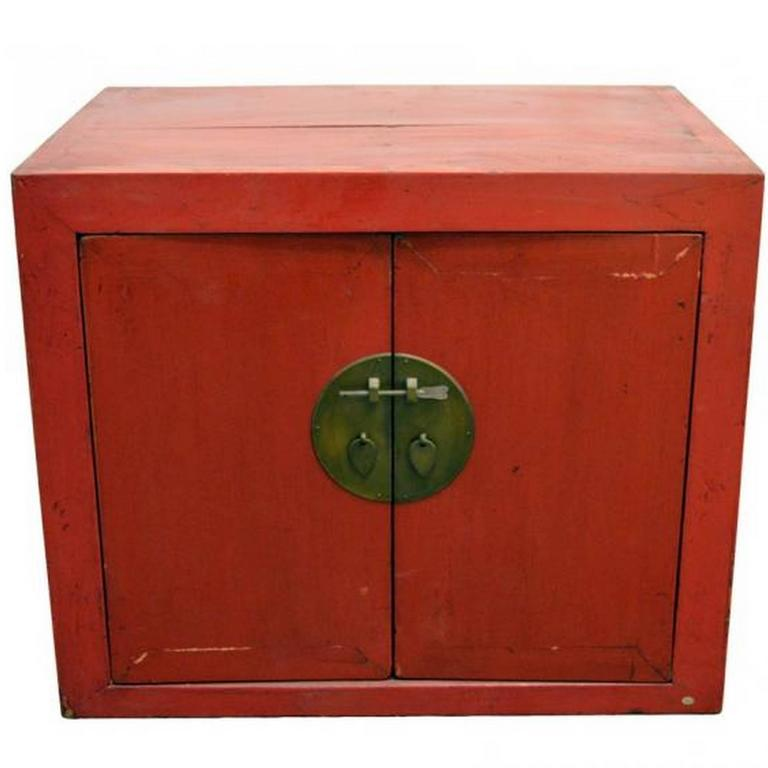 Antique Chinese Red Lacquer Cabinet with Brass Hardware from the 20th Century