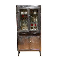 1950s English Polished Aluminum Glass Door Cabinet with Drawer and Lower Doors