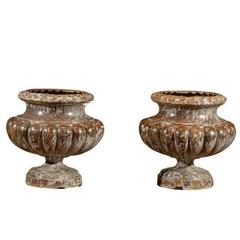 Pair of French Mid 19th Century Alfred Corneau Marbleized Iron Urns