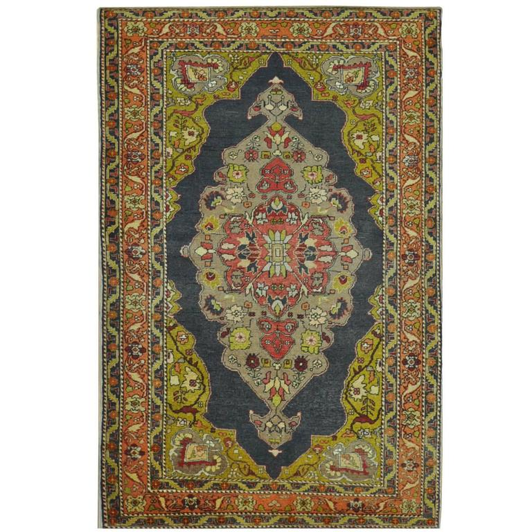 Small Hand-Knotted Vintage Turkish Rug
