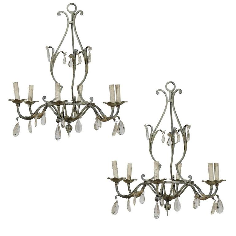 A Pair of French Painted Iron and Crystal Six-Light Chandeliers with Leaf Motifs