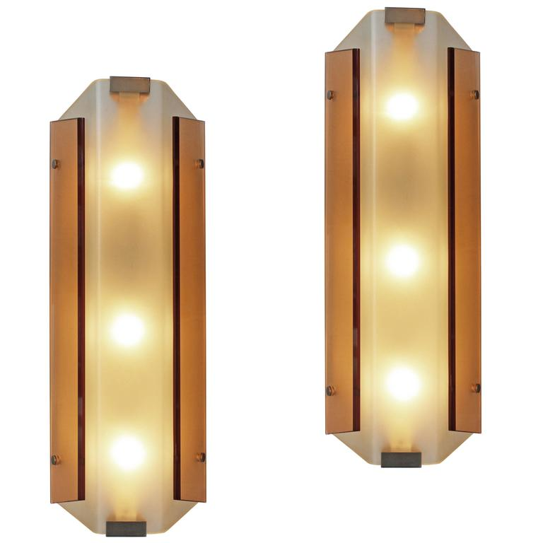 Rare pair of wall lights by Stilnovo For Sale
