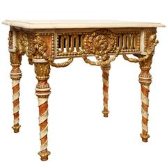 A Continental Parcel Gilt and Polychrome Side Table
