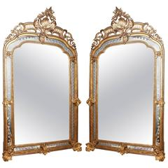 Monumental Pair of Period Louis XV Carved Giltwood Mirrors