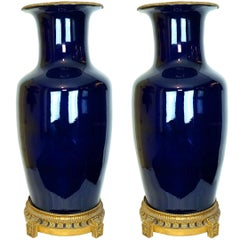 Pair of Palace Size Bronze Mounted Cobalt Blue Porcelain Vases