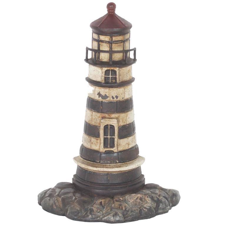 Antique Cast Iron Lighthouse Door Stop 1