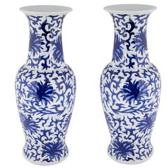 Pair of Chinese White and Blue Ceramic Vases with Floral Motifs