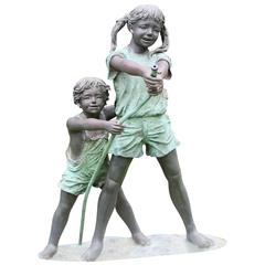 Bronze Boy and Girl with Hose Sculpture