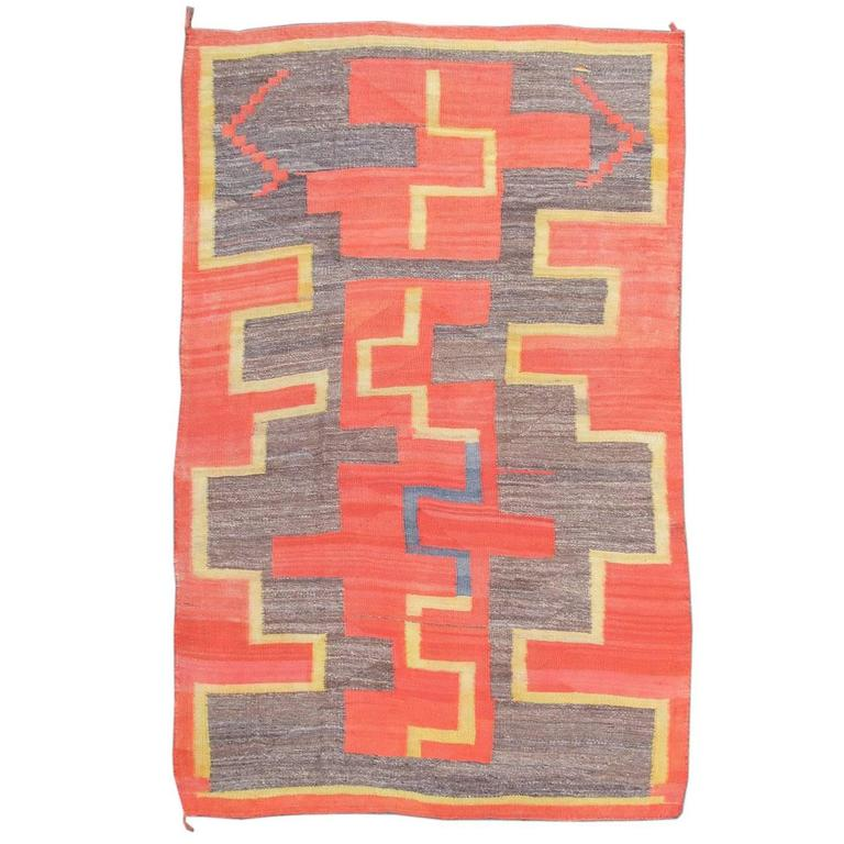 Late 19th Century Red, Yellow, and Brown Navajo Rug