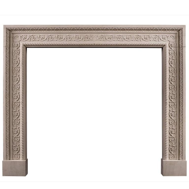 Carved English Stone Fireplace with Scrolled Detailing