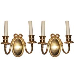 Pair of Neoclassic Oval Gilt Bronze Sconces