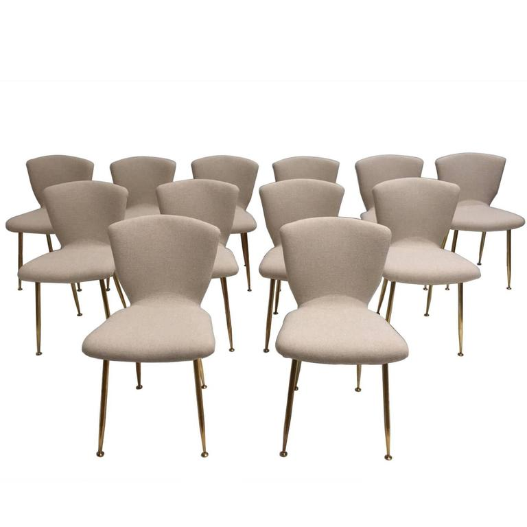 12 dining chairs by Louis Sognot for ARFLEX,1959. Brass legs,Upholstery restored 1