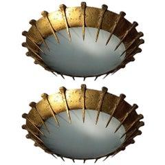 Pair of Large Gilt Metal Sunburst Fixtures