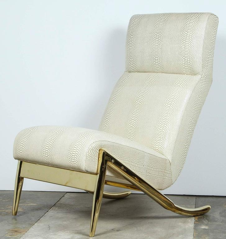 Contemporary Paul Marra Slipper Chair in unlacquered polished brass and upholstered in faux python. Brass is unlacquered therefore will patina naturally.  By order. Price quoted is per each.