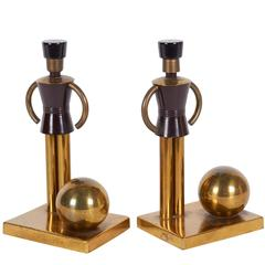 Walter Von Nessen Figural Bookends in Brass and Bakelite
