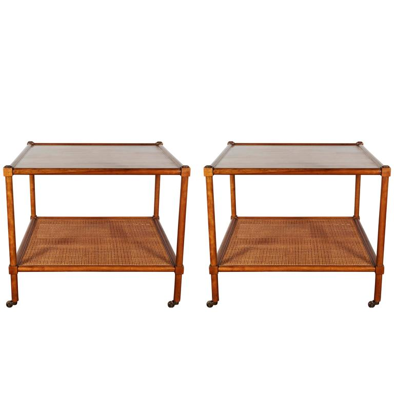 Pair Of Baker Rolling Tables With Cane Shelf For Sale