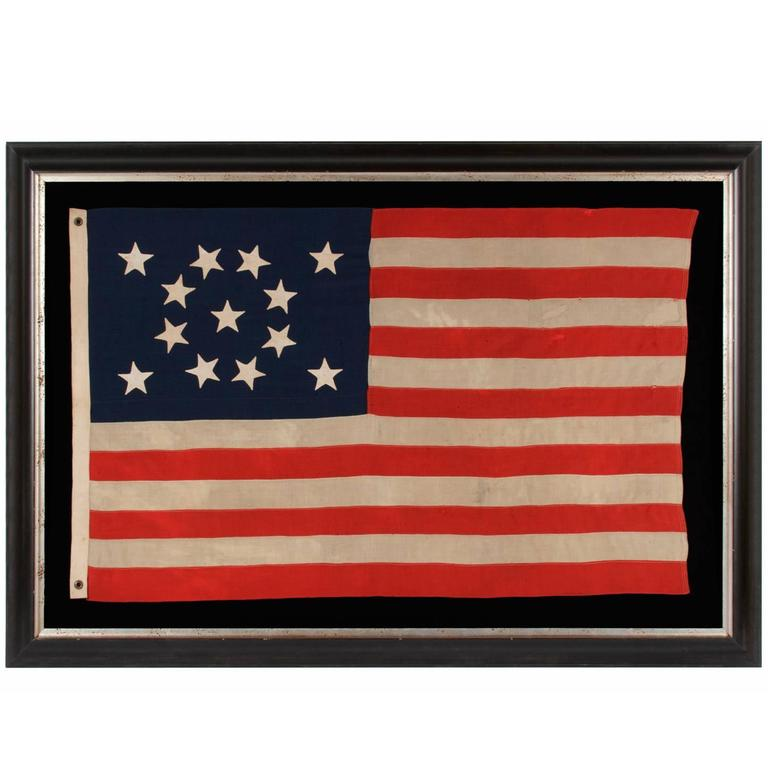 13 Hand-Sewn Stars in a Beautiful Medallion Configuration on a Small-Scale Flag For Sale