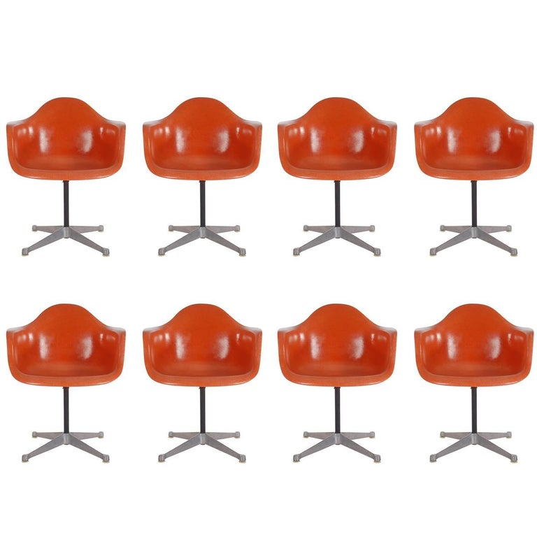 Mid-Century Charles Eames for Herman Miller Fiberglass Dining Chairs in Orange For Sale