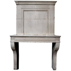 Late 18th Century French Louis XVI Limestone Fireplace with Trumeau