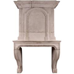 Early 18th Century Louis XIV Limestone Fireplace with Pannelled Trumeau