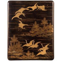 A Large Japanese Gold Lacquer Box (Bunko) Depicting Cranes and Pine Trees