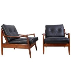 Pair of Mid-Century Teak Framed Leather Armchairs, circa 1960
