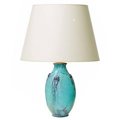Elegant Table Lamp with Carved Frond Motifs and Teal-Gray Glaze