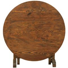 A French Wine Tasting Table of Medium Size with Nice Wood Grain and Round Shape